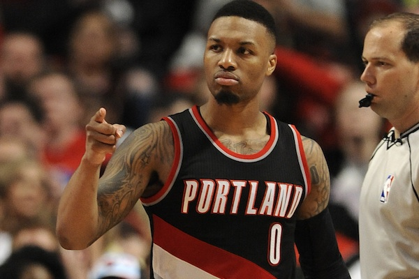 Portland Trail Blazers' Damian Lillard (0), celebrates after making a basket during the second half of an NBA basketball game against the Chicago Bulls, Saturday, Feb. 27, 2016, in Chicago. (AP Photo/Paul Beaty)