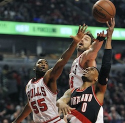Portland Trail Blazers' Damian Lillard (0) goes up for a shot against Chicago Bulls' Pau Gasol (16) and E'Twaun Moore (55) during the first half of an NBA basketball game Saturday, Feb. 27, 2016, in Chicago. (AP Photo/Paul Beaty)