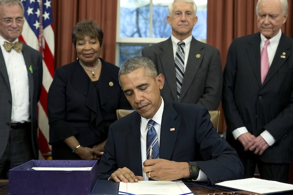President Barack Obama, joined by from left, Rep. Earl Blumenauer, D-Org., Rep. Eddie Johnson, D-Texas., Rep. David Reichert, R-Wash., and Sen. Orrin Hatch, R-Utah, signs House Resolution 644, the Trade Facilitation and Trade Enforcement Act of 2015, in the Oval Office of the White House, in Washington,Wednesday, Feb. 24, 2016. (AP Photo/Carolyn Kaster)