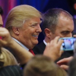 Republican presidential candidate Donald Trump smiles during a South Carolina Republican primary night event, Saturday, Feb. 20, 2016 in Spartanburg, S.C. (AP Photo/Paul Sancya)