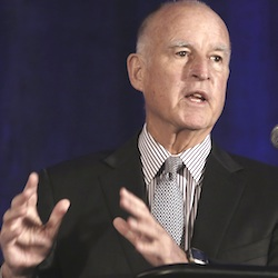 California Gov. Jerry Brown speaks at the Association of California Water Agencies conference in Sacramento, Calif. Brown joined with the governors of 16 other states to announce an agreement to work together in seeking cleaner energy and transportation and to build a better electrical grid, Tuesday, Feb. 16, 2016. (AP Photo/Rich Pedroncelli