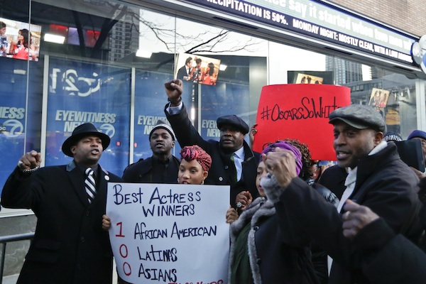 Protestors gather outside of the offices of WABC-TV to rally for more diversity in the film industry Sunday, Feb. 28, 2016, in New York. (AP Photo/Frank Franklin II)