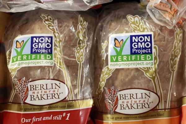 Products labeled with Non Genetically Modified Organism (GMO) are sold at the Lassens Natural Foods & Vitamins store in Los Feliz district of Los Angeles. President Barack Obama on July 29, 2016, has signed into law a bill that will require labeling of genetically modified ingredients for the first time. The legislation will require most food packages to carry a text label, a symbol or an electronic code readable by smartphone that indicates whether the food contains genetically modified ingredients, or GMOs. (AP Photo/Damian Dovarganes, File)