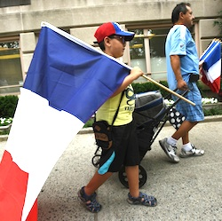 Brandon Chavez, 7, and his uncle, Francisco Miranda, hold French flags in front of French consulate in New York, Friday, July 15, 2016. Scores of people were killed Thursday night after a Tunisian man drove a truck through crowds celebrating Bastille Day in Nice, France. (Viorel Florescu/The Record of Bergen County via AP)