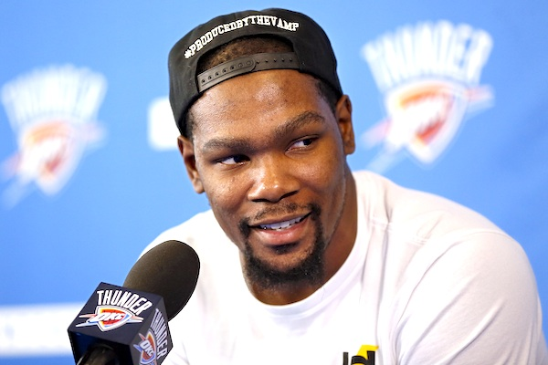 Oklahoma City's Kevin Durant (35) speaks during a news conference at the team's practice facility in Oklahoma City, June 1, 2016. Durant announced Monday, July 4, 2016 that he is joining All-Stars Stephen Curry and Klay Thompson with the Golden State Warriors. Durant made the decision public on The Players' Tribune Monday morning. He can't officially sign until July 7. (Nate Billings/The Oklahoman via AP)