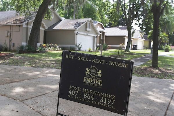 A real estate sign in the Piedmont Park neighborhood in Apopka, Fla., a former agricultural hub now crowded with housing developments, Thursday, April 14, 2016. Where one in 10 homes was once a rental, now more than a third are. (AP Photo/John Raoux)