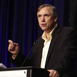 U.S. Sen. Jeff Merkley of Oregon addresses attendees of the state convention, Saturday, June 18, 2016, in Tacoma, Wash. Merkley, who had previously endorsed Bernie Sanders, told Democrats that they need to unite behind Hillary Clinton in order to defeat Donald Trump in November. (AP Photo/Rachel La Corte)