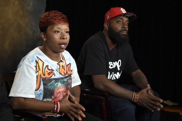 The parents of Michael Brown, Lesley McSpadden, left, and Michael Brown, Sr., right, sit for an interview with The Associated Press in Washington Sept. 27, 2014. Attorneys representing Ferguson, Mo., its former police chief and an ex-officer in a wrongful-death lawsuit by Brown's parents are pressing the latest quest for access to any of the late 18-year-old's juvenile records. Anthony Gray, a Brown family attorney, has said any brush by Brown with the juvenile court system is irrelevant to whether Brown's 2014 death resulted from excessive police force.(AP Photo/Susan Walsh, File)