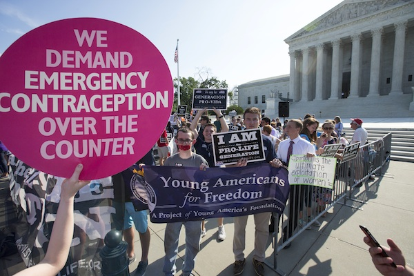 Activists demonstrate in front of the Supreme Court in Washington, Monday, June 27, 2016, as the justices close out the term with decisions on abortion, guns, and public corruption are expected. (AP Photo/J. Scott Applewhite)