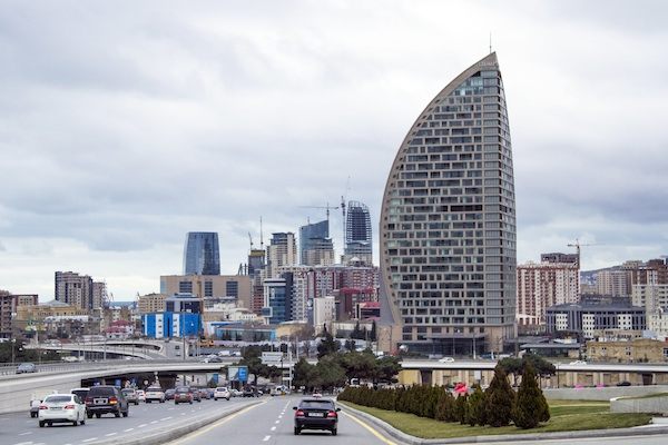 "The Trump International Hotel, the highest building, is seen in Baku, Azerbaijan. Just six months before he launched his presidential campaign, Donald Trump announced a new real estate project in Baku. The partner: the 35-year-old son of an Azerbaijani minister suspected by U.S. diplomats of corruption and laundering money for Iran's military and described by them as ""notoriously corrupt."" Now, only weeks after Ivanka Trump released a publicity video of the nearly finished project, references to the Baku project have disappeared from Trump's website. (AP Photo/Aida Sultanova, File)"