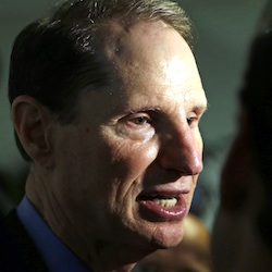 U.S. Sen. Ron Wyden, D-Ore., speaks after a news conference in Portland, Ore. in September 2015. Wyden is pushing for more answers on why doctors and patient advocates with financial ties to the pharmaceutical industry came to serve on a panel that advises the federal government on pain issues. (AP Photo/Don Ryan, File)