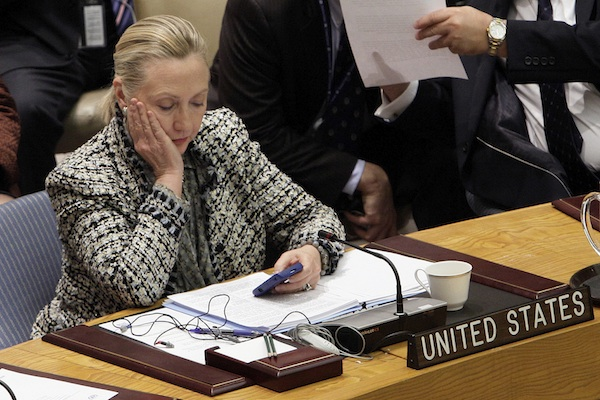 In March 2012, then-Secretary of State Hillary Rodham Clinton checks her mobile phone after her address to the Security Council at United Nations headquarters. An impromptu meeting between Bill Clinton and the nation's top cop could further undermine Hillary Clinton's efforts to convince voters to place their trust in her, highlighting perhaps her biggest vulnerability. (AP Photo/Richard Drew)