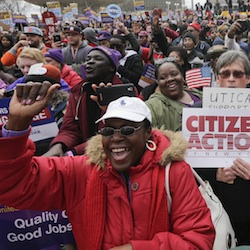 "Supporters of a $15 minimum wage rally at the Empire State Plaza on Tuesday, March 15, 2016, in Albany, N.Y. New York Gov. Andrew Cuomo says raising the state's minimum wage to $15 an hour will ""show the nation the way forward"" and offer working families hope instead of the fear mongering that he says has marked this year's presidential race. (AP Photo/Mike Groll)"