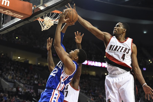 Portland Trail Blazers forward Maurice Harkless (4) blocks the shot of Philadelphia 76ers forward Richaun Holmes (22) during the first quarter of an NBA basketball game in Portland, Ore., Saturday, March 26, 2016. (AP Photo/Steve Dykes)