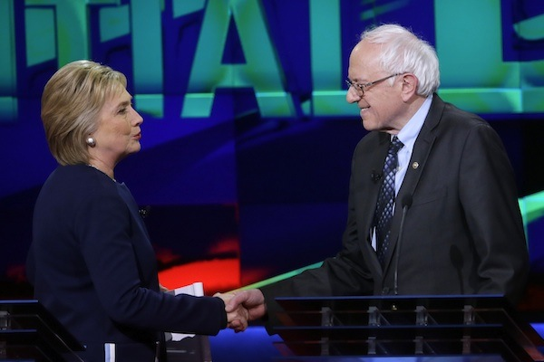 Democratic presidential candidates, Hillary Clinton and Sen. Bernie Sanders, I-Vt., right, shake hands at the end of a Democratic presidential primary debate at the University of Michigan-Flint, Sunday, March 6, 2016, in Flint, Mich. (AP Photo/Carlos Osorio)