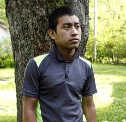Candelario Jimon Alonzo, 16, stands in the yard of his uncle's home in Memphis, Tenn.