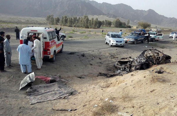 freelance photographer Abdul Malik on Saturday, May 21, 2016, purports to show volunteers standing near the wreckage of the destroyed vehicle, in which Mullah Mohammad Akhtar Mansour was allegedly traveling in the Ahmed Wal area in Baluchistan province of Pakistan, near Afghanistan border. A senior commander of the Afghan Taliban confirmed on Sunday that the extremist group's leader, Mullah Mohammad Akhtar Mansour, has been killed in a U.S. drone strike. (AP Photo/Abdul Malik)