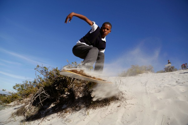 Poor South African Boys Find an Escape in Sandboarding