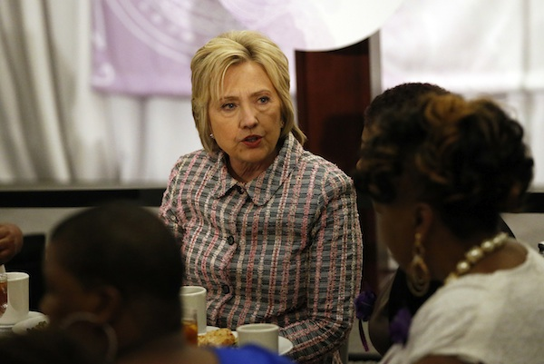 Democratic presidential candidate Hillary Clinton talks to members of the Trayvon Martin Foundation's
