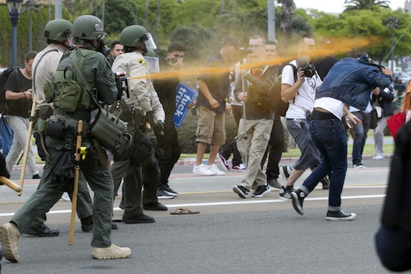 Police pepper sprayed protesters as they moved them down Harbor Drive in San Diego Friday, May 27, 2016. About a thousand Trump protesters demonstrated outside San Diego's convention center as Republican presidential candidate Donald Trump spoke inside to an enthusiastic crowd of supporters packed in tight. Several protesters were arrested. (John Gibbins/The San Diego Union-Tribune via AP)