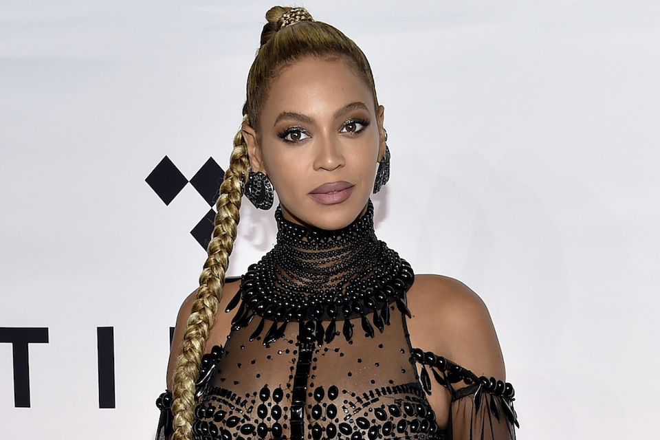 Singer Beyonce Knowles attends the Tidal X: 1015 benefit concert in New York, Oct. 15, 2016. Beyonce is among 100 black luminaries being recognized by Ebony magazine. The magazine revealed its annual Power 100 list Friday, Nov. 4, which recognizes outstanding achievements by black entertainers, corporate heads and civic leaders. (Photo by Evan Agostini/Invision/AP, File)