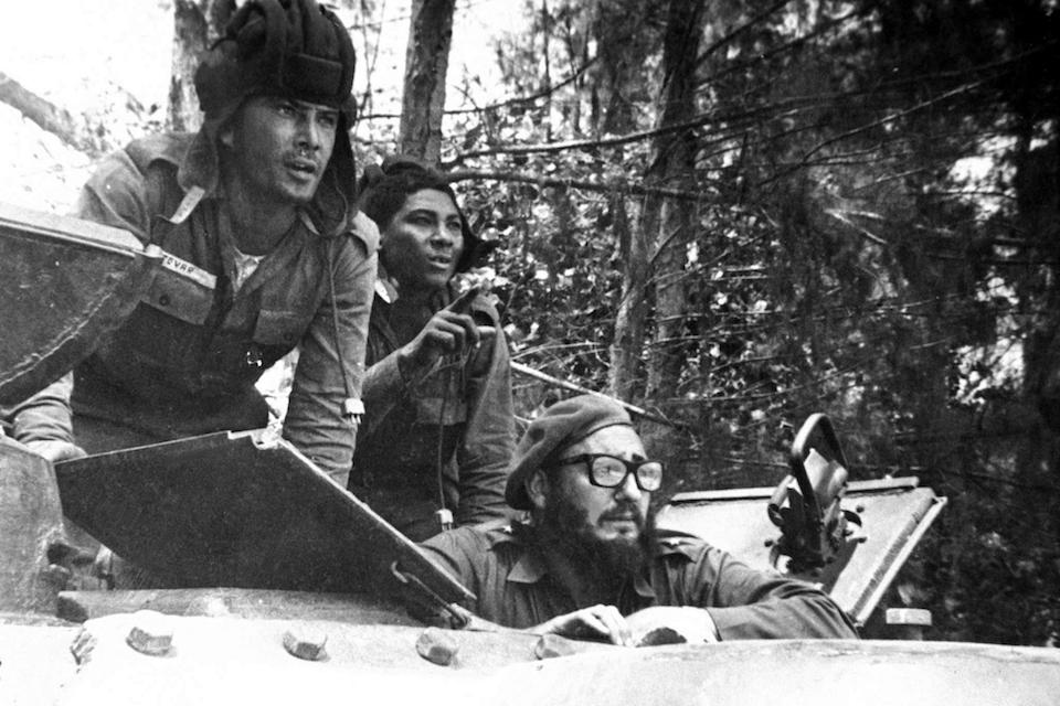 Cuba's leader Fidel Castro, bottom, looks out from a tank during the Bay of Pigs invasion in Cuba, April 1961. Former President Fidel Castro, who led a rebel army to improbable victory in Cuba, embraced Soviet-style communism and defied the power of 10 U.S. presidents during his half century rule, has died at age 90. The bearded revolutionary, who survived a crippling U.S. trade embargo as well as dozens, possibly hundreds, of assassination plots, died eight years after ill health forced him to formally hand power over to his younger brother Raul, who announced his death late Friday, Nov. 25, 2016, on state television. (AP Photo/Raul Corrales, The Canadian Press, File)