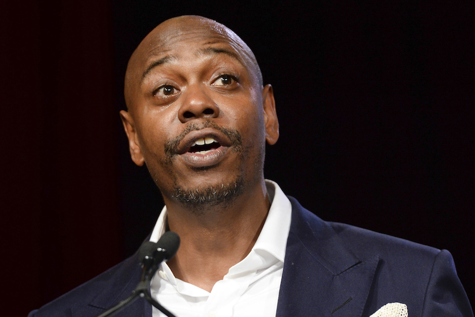 "Comedian Dave Chappelle speaks at the RUSH Philanthropic Arts Foundation's Art for Life Benefit in New York, July 18, 2015. Chappelle is set to host NBC's ""Saturday Night Live"" on Nov. 12, marking his debut appearance on the show. He will be joined by hip-hop group A Tribe Called Quest. (Photo by Scott Roth/Invision/AP, File)"