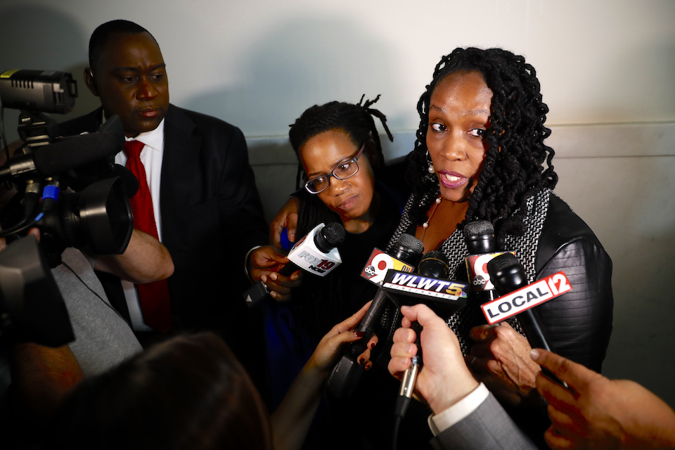 DaShonda Reid, Sam DuBose's fiance, speaks to the media outside of court on the third day of jury deliberations in the murder trial against Ray Tensing, Friday, Nov. 11, 2016, in Cincinnati. Tensing, a former University of Cincinnati police officer, is charged with murdering Sam DuBose while on duty during a routine traffic stop on July 19, 2015. (AP Photo/John Minchillo)
