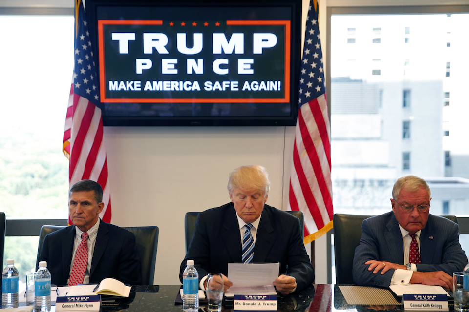Then-Republican presidential candidate Donald Trump participates in a roundtable discussion on national security in his offices in Trump Tower in New York, with Ret. Army Gen. Mike Flynn, left, Ret. Army Lt. Gen. Keith Kellogg, August 2016. Trump's transition team is rich with lobbyists, a climate change-denier and an ex-federal prosecutor involved in the mass firings of U.S. attorneys. Kellogg has been working closely with Trump adviser Flynn, advising the Trump campaign on matters relating to foreign policy and national security. (AP Photo/Gerald Herbert)