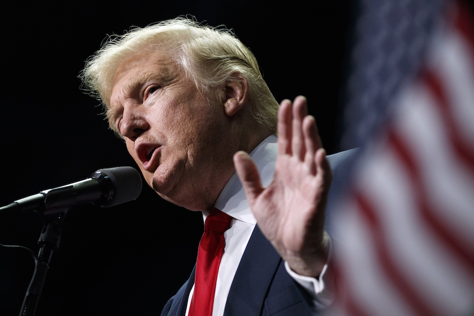 Donald Trump speaks in Hershey, Pa., Nov. 4, 2016. President-elect Trump holds stock in the company building the disputed Dakota Access oil pipeline, and pipeline opponents warn that Trump's investments could undercut any decision he makes on the $3.8 billion project as president. (AP Photo/ Evan Vucci, File)
