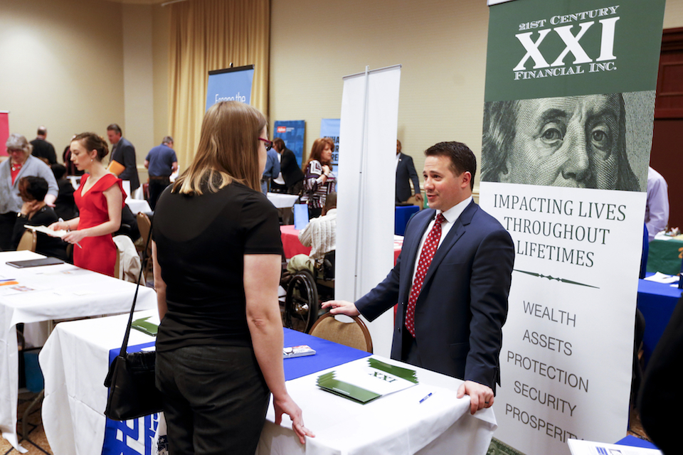 Recruiters talk to those looking at employment opportunities at a job fair in Pittsburgh, March 30, 2016. States that voted for Hillary Clinton in last week's presidential election reported stronger job growth in the previous year than states that supported Donald Trump, according to data released by the Labor Department Friday, Nov. 18. (AP Photo/Keith Srakocic)