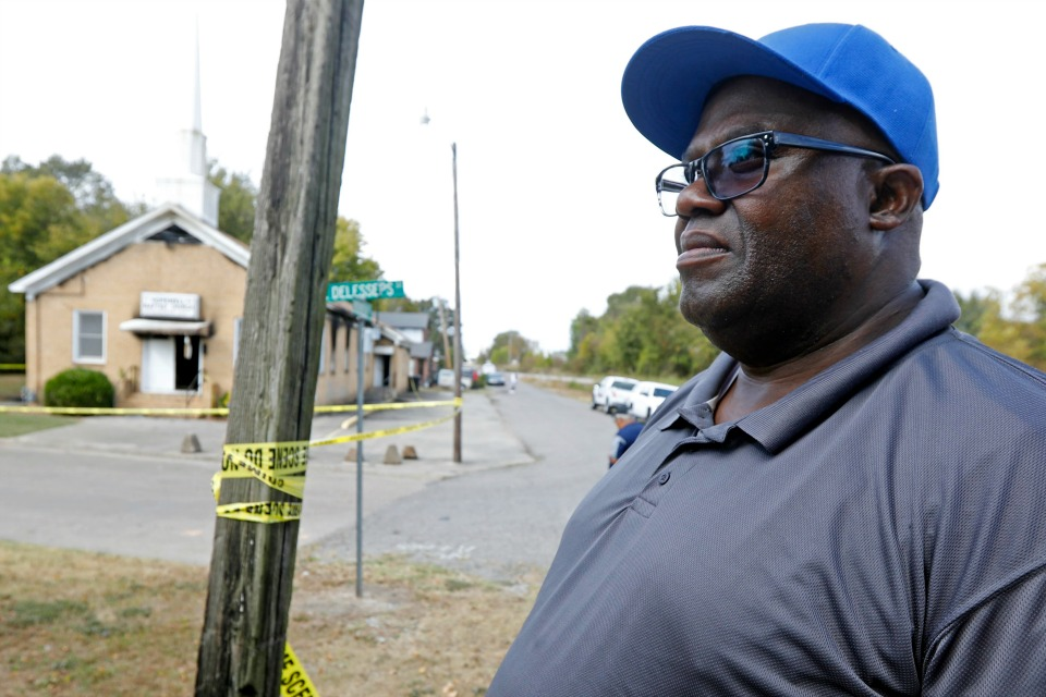 "Bishop Clarence Green stands outside his fire damaged 200-member Hopewell M.B. Baptist Church in Greenville, Miss., Wednesday, Nov. 2, 2016. A Mississippi mayor is calling it a hate crime as arson investigators collect evidence at a black church that was heavily damaged by fire and tagged with ""Vote Trump"" in silver spray paint. (AP Photo/Rogelio V. Solis)"