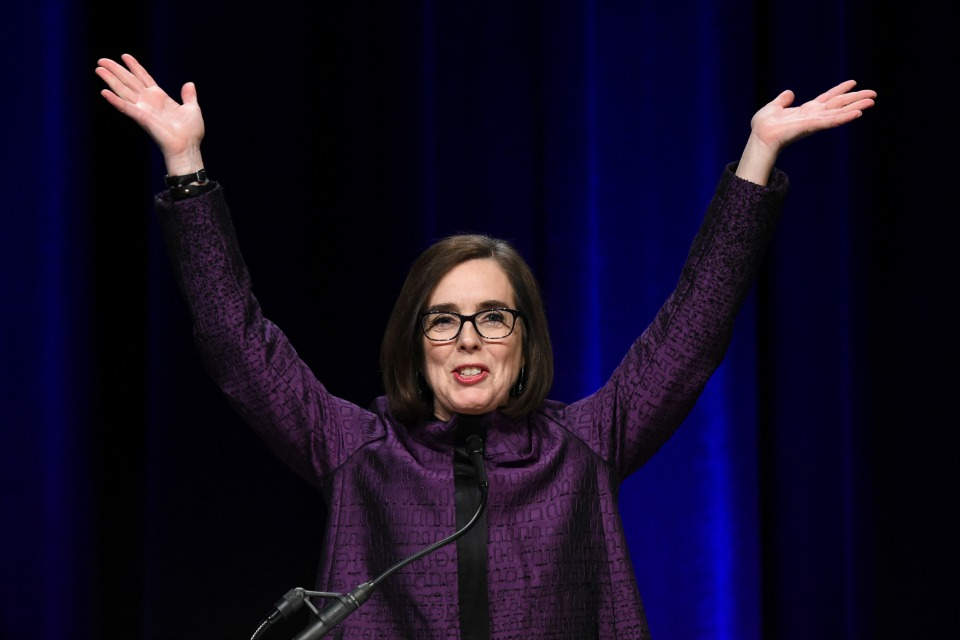 Oregon Gov, Kate Brown speaks to the crowd of supporters after being elected as former Oregon Gov. Barbara Roberts, right, looks on at the Oregon Convention Center in Portland, Ore., on Tuesday, Nov. 8, 2016. (AP Photo/Steve Dykes)