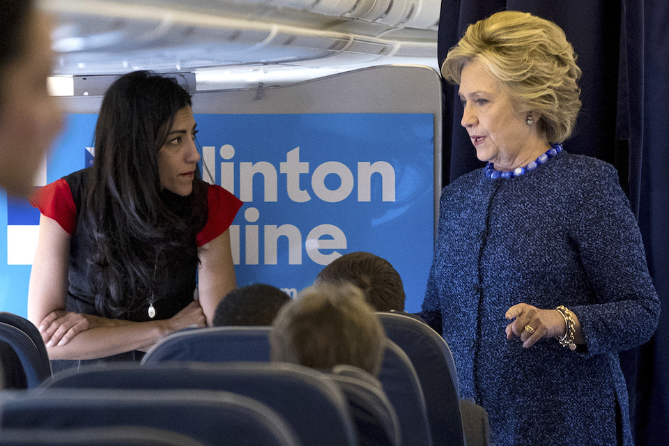 Democratic presidential candidate Hillary Clinton speaks with senior aide Huma Abedin aboard her campaign plane at Westchester County Airport in White Plains Oct. 28, 2016. The longtime Hillary Clinton aide at the center of a renewed FBI email investigation testified under oath four months ago she never deleted old emails, despite promising in 2013 not to take sensitive files when she left the State Department. (AP Photo/Andrew Harnik, File)