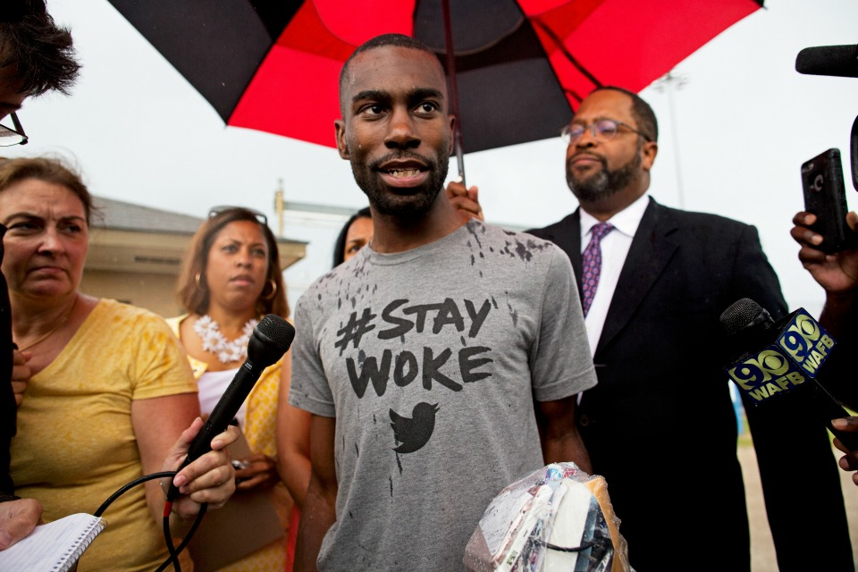 DeRay Mckesson talks to the media after his release from the Baton Rouge jail in Baton Rouge, La.