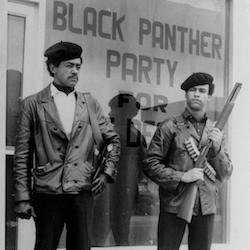 Black Panther national chairman Bobby Seale, left, wearing a Colt .45, and Huey Newton, right, defense minister with a bandoleer and shotgun are shown in Oakland, Calif. Hundreds of former Black Panthers from around the world are expected to gather in Oakland, Calif., for a four-day conference that started Thursday, Oct. 20, 2016. The Panthers emerged from the gritty city 50 years ago, declaring a new party dedicated to defending African-Americans against police brutality and protecting their rights. (The San Francisco Examiner via AP, File)