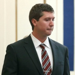 Ray Tensing enters Judge Megan Shanahan's courtroom for his pre-trial hearing on Friday, Oct. 14, 2016, in Cincinnati. The former University of Cincinnati police officer is charged with killing Sam DuBose, an unarmed black man during a traffic stop over a missing front license plate. (Amanda Rossmann /The Cincinnati Enquirer via AP, Pool)