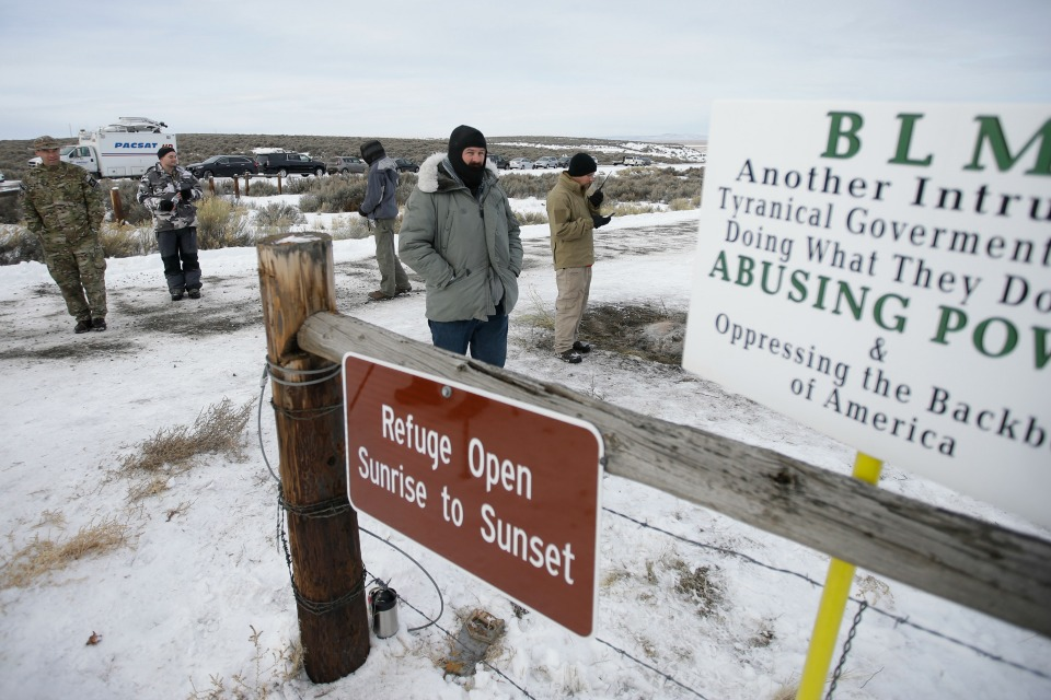 In this Monday, Jan. 4, 2016, file photo, members of the group occupying the Malheur National Wildlife Refuge headquarters stand guard near Burns, Ore. The leaders of an armed group that took over a national wildlife refuge in rural Oregon have been found not guilty of conspiracy and possession of firearms at a federal facility. A jury on Thursday, Oct. 27, 2016, exonerated brothers Ammon and Ryan Bundy and five others of conspiring to impede federal workers from their jobs at the Malheur National Wildlife Refuge. (AP Photo/Rick Bowmer, File)
