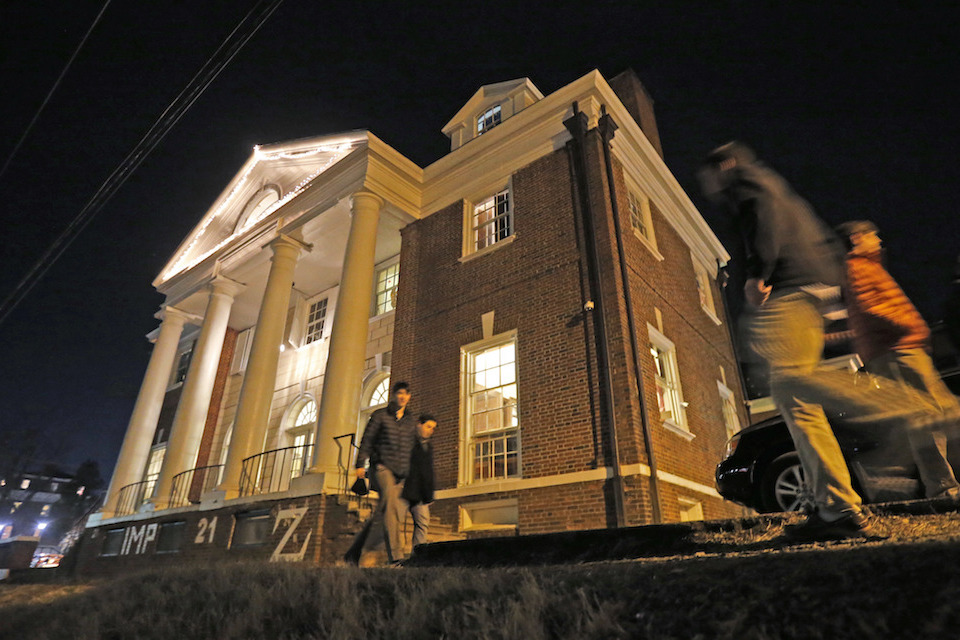 "Students participate in rush pass by the Phi Kappa Psi house at the University of Virginia in Charlottesville, Va.Jan. 15, 2015. The house was depicted in a debunked Rolling Stone story as the site of a rape in September of 2012. A defamation trial against the magazine is set to begin on Monday, Oct. 17, 2016, over its article about ""Jackie"" and her harrowing account of being gang raped in a fraternity initiation. (AP Photo/Steve Helber, File)"