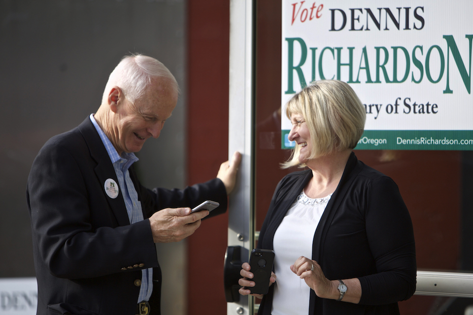 Oregon Republican Secretary of State candidate Dennis Richardson, left, and his wife Cathy Richardson take a phone call during a primary election night gathering for supporters in Portland, Ore. May 17, 2016. With a Republican threatening to take a state-wide office for the first time in many years in Oregon, the battle for secretary of state has become the hottest state race. (AP Photo/Craig Mitchelldyer, file)