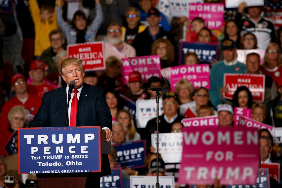 In this Oct. 27, 2016 file photo, Republican presidential candidate Donald Trump speaks during a campaign rally in Toledo, Ohio. AP-GfK poll shows most Americans are upset by Trump's comments about women and believe the accusations made by several women that he kissed and grouped them without their consent. Trump is far behind Clinton among female voters. (AP Photo/ Evan Vucci, File)