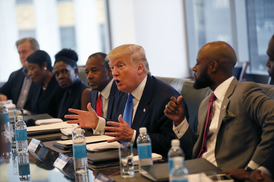 Republican presidential candidate Donald Trump holds a roundtable meeting with the Republican Leadership Initiative in his offices at Trump Tower in New York, Aug. 25, 2016 . Dr. Ben Carson is seated next to Trump at center. In the decades since the Voting Rights Act of 1965 widely enfranchised African-Americans, they have become a reliable Democratic bloc. President Barack Obama, the nation's first black president, won at least 95 percent and 93 percent of the black vote in his two victories, sending Republican to historical lows among African-Americans, according to exit polls. (AP Photo/Gerald Herbert, File)
