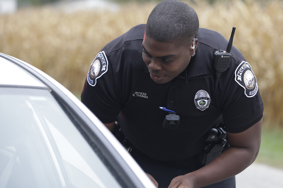 A body camera is attached to the uniform of Whitestown Police Department officer Reggie Thomas during a traffic stop, in Whitestown, Ind. Tuesday, Sept. 29, 2015. Police departments in at least two states are shelving the body cameras they outfitted their officers with, blaming the formidable costs of storing the video. About a third of the nation's 18,000 police agencies either have pilot body camera programs or full programs in place, despite the cost concerns. (AP Photo/Darron Cummings)