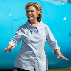 Democratic presidential candidate Hillary Clinton, right, accompanied by Democratic vice presidential candidate, Sen. Tim Kaine, D-Va., left, arrives at Cleveland Hopkins International Airport in Cleveland, Ohio, Monday, Sept. 5, 2016, after traveling from Westchester County Airport in White Plains, N.Y. (AP Photo/Andrew Harnik)