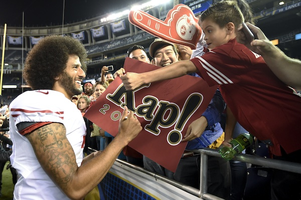 San Francisco 49ers quarterback Colin Kaepernick greets fans after the 49ers' 31-21 win over the San Diego Chargers during an NFL preseason football game Thursday, Sept. 1, 2016, in San Diego. (AP Photo/Denis Poroy)