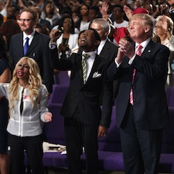 Republican presidential candidate Donald Trump shown during a church service at Great Faith Ministries, Saturday, Sept. 3, 2016, in Detroit. (AP Photo/Evan Vucci)