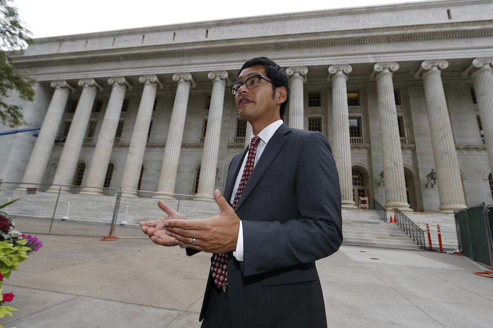 Dale Ho, director of the American Civil Liberties Union's Voting Rights Project from New York City, responds to questions outside the 10th U.S. Circuit Court of Appeals after delivering an argument in the legal fight over how the state of Kansas enforces its proof-of-citizenship requirement for voters who register at motor vehicle offices on Tuesday, Aug. 23, 2016 in Denver. The case was before the Appeals Court after a federal judge in May temporarily blocked Kansas from disenfranchising about 18,000 who registered to vote at motor vehicle offices without providing citizenship paperwork such as birth certificates or naturalization papers. (AP Photo/David Zalubowski)
