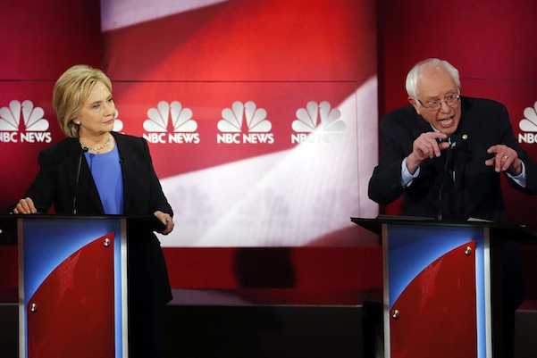 Democratic presidential candidate, Sen. Bernie Sanders, I-Vt., right, speaks at the NBC, YouTube Democratic presidential debate at the Gaillard Center, Sunday, Jan. 17, 2016, in Charleston, S.C. To the left is Democratic presidential candidate, Hillary Clinton .(AP Photo/Stephen B. Morton)