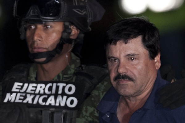 "Mexican drug lord Joaquin ""El Chapo"" Guzman, right, is escorted by soldiers and marines to a waiting helicopter, at a federal hangar in Mexico City, Friday, Jan. 8, 2016. The world's most wanted drug lord was recaptured by Mexican marines Friday, six months after he fled through a tunnel from a maximum security prison in an escape that deeply embarrassed the government and strained ties with the United States.(AP Photo/Marco Ugarte)"