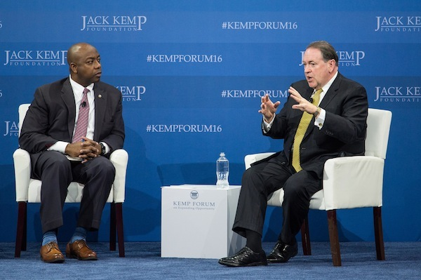 "Republican presidential candidate Mike Huckabee, right speaks with Sen. Tim Scott, R-S.C., left, at an economic forum, Saturday, Jan. 9, 2016, in Columbia, S.C. Huckabee pitched his ""fair tax,"" a single-rate consumption tax to replace all other taxes on wages, investments on inheritance. ""It's a powerful unlocking of the economy,"" Huckabee said, noting that he would allow something similar to the Earned Income Tax Credit to ease the tax burden on low-income households. (AP Photo/Sean Rayford)"
